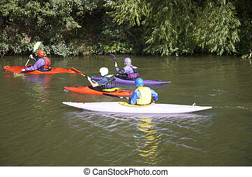 Canoeing - Four people canoeing on the river medway