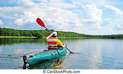 Canoeing - man canoeing on a lake