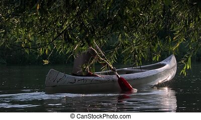 Canoeing on a lake - Canoeing in a beautiful natural...