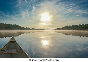 Canoeing on a misty summer morning on Corry Lake.