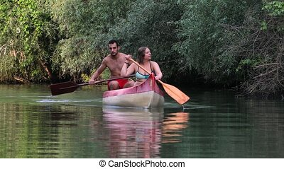 Canoeing on a river - Canoeing in beautiful natural...