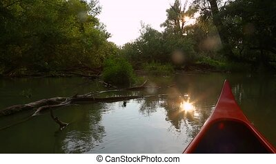 Canoeing on a river - Canoeing in the wilderness, sunlight...