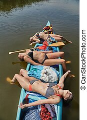 Canoeing on a river, girls in the boat