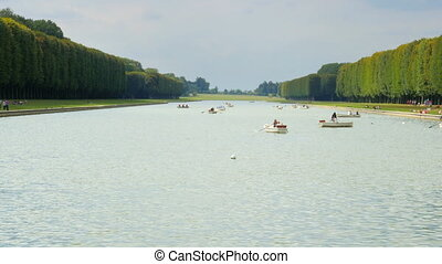 """canoeing versailles palace lake on boat, paris, france, 4k"""