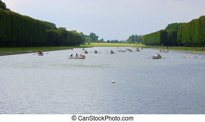 """canoeing versailles palace lake on boat, paris, france,..."