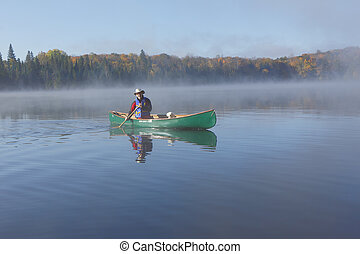 Canoeist on an Autumn Lake