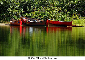 Colourful canoes around the portage
