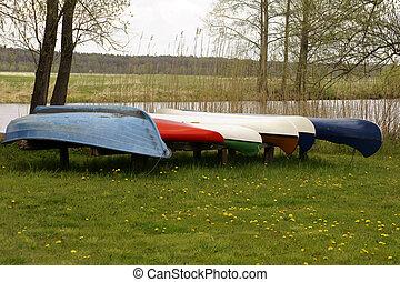 Canoes jacked riverside