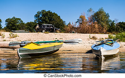 canoes on a shore