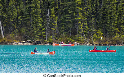 Canoes on Blue Water of Lake Louise