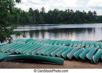 Canoes on lake shore