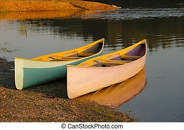 Canoes parked on the riverside