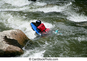 Canoing down rapids