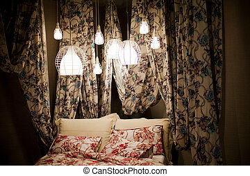 Canopy bed with floral curtains
