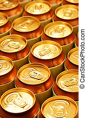 Cans - Much of gold drink cans close up