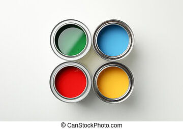 Cans of different paints on white background, top view
