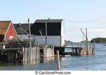 Fishing Shacks - Fishing shacks standing over the water -...