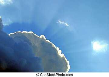 Cloud 9 - A fluffy cloud with sun rays breaking through. A...