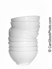 Stack of White Bowls - A stack of plain white bowls against...