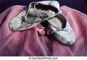 Ballet shoes - Still life of worn ballet slippers and tutu...