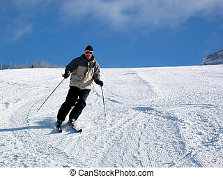 Skiing - A downhill skier