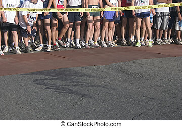 Ready, Set, Go - Runners lined up at the start of a race