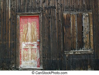 Red Door 1 - Red door and boarded up window - surviving...