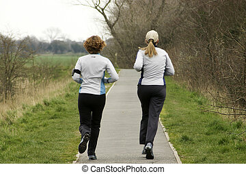 Joggers - two joggers on a country path