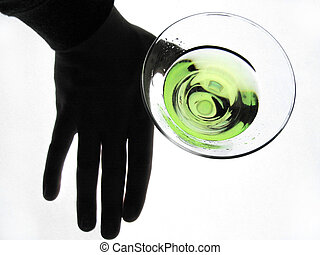 Hand Holding Glass - silhouetted hand holding a glass of...