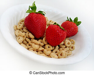 Strawberries O's 2 - Three strawberries in a bowl of cereal...