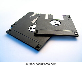 Three floppy disks - 3, 3 1/2 inch floppy disks on white...