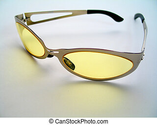 Yellow Sunglasses - Close up of a pair of stylish yellow...