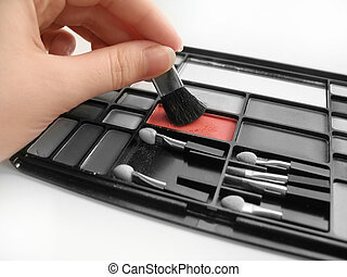 Red Blush - Hand and one compartment of blush left...