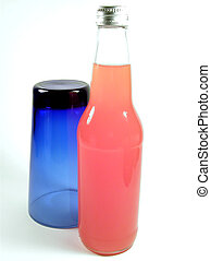 Blue and Orange - A cobalt blue drinking glass and a bottle...