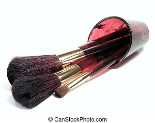 Matching Brushes - Make-up brushes, spilling out of a...