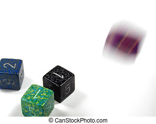 Rolling Dice - Colorful dice, some in motion, some at rest.