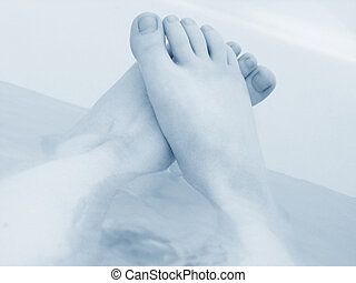Relaxing Feet - Relaxing feet in bathtub, blue tones