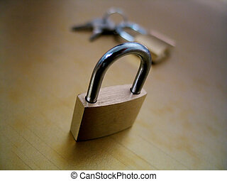 Lock and Keys III - Two padlocks and a set of keys on a gold...