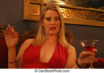 Red and gold. - A girl holding a martini glass. Soft focus...