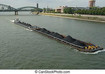a boat on Rhein - big transport boat sailing on Rhain river