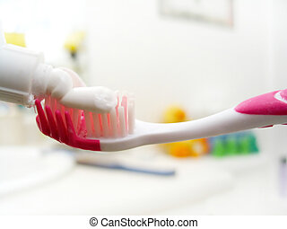 Toothpaste - Macro shot of a toothbrush with toothpaste...