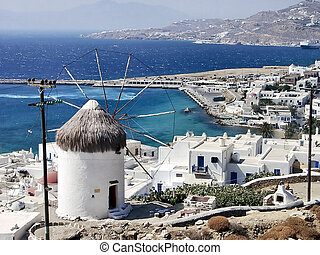 Mykonos - typical view of Mykonos and one of his windmills,...
