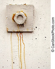 Hexnut - A hexnut bolted into the side of a wall, with rust...