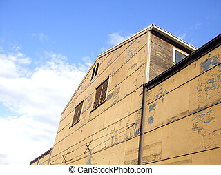 Old Warehouse - An old warehouse against a blue sky. Located...