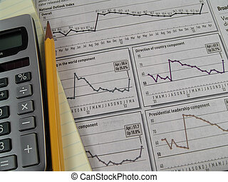 Stock Research 2 - Photo of Stock Charts and Calculator
