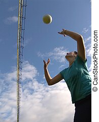 Playing Volleyball - Young woman playing volleyball