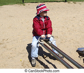 Child on SeeSaw - Photo of Child on SeeSaw