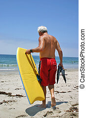 Board Time 3 - A man preparing to hit the waves with his...