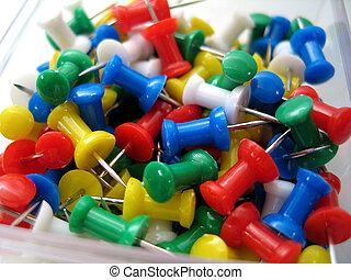 Thumb Tacks - Close up on multi-colored thumb tacks.