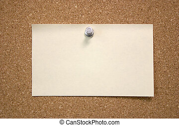 Post It - A blank post it note pinned to a bulletin board.